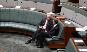 Communication minister Malcolm Turnbull talks to the shadow assistant treasurer Andrew Leigh after question time.