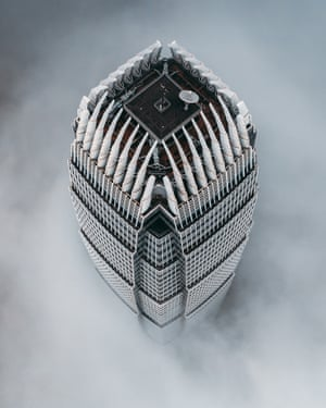 The International Finance Centre in Hong Kong rising above the clouds