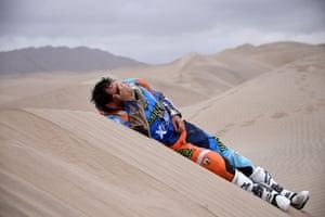 Stage 3: San Juan de Marcona to Arequipa, PeruBrazilian biker Marcos Colvero lies on the sand after crashing