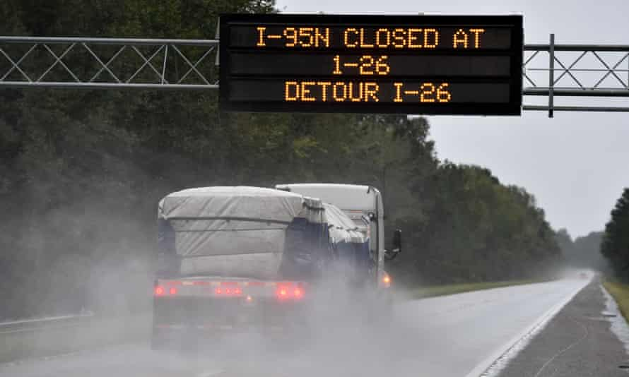 An alert board announces the closing of Interstate 95 due to the flash floods at the crossing with Interstate 26 in South Carolina on Monday.