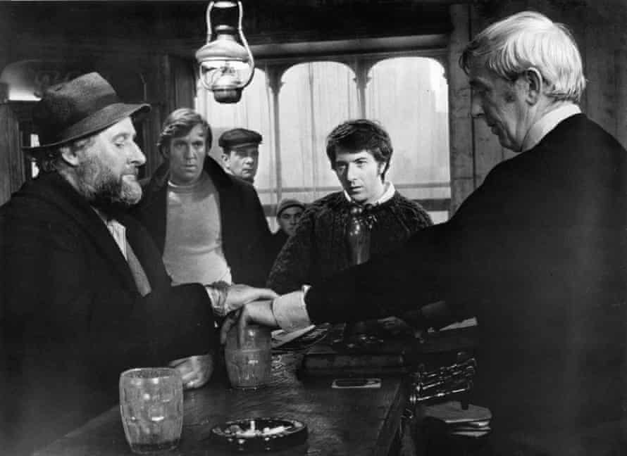 Peter Vaughan, left, and Dustin Hoffman, centre, in a scene from Straw Dogs, 1971. Williams pronounced of its director Sam Peckinpah that 'the man was sick'.