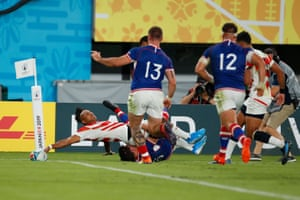 Japan's Kotaro Matsushima loses control of the ball as he attempts to score.