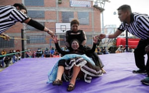 Silvana La Poderosa and Simplemente Maria, cholitas wrestlers, fight during their return to the ring.