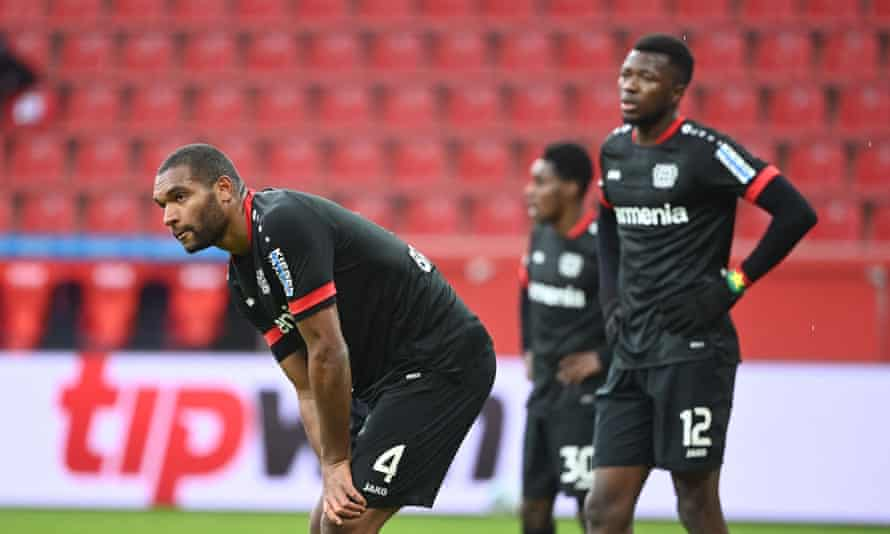 Leverkusen defenders Jonathan Tah and Edmond Tapsoba react after falling behind at home to Arminia Bielefeld.