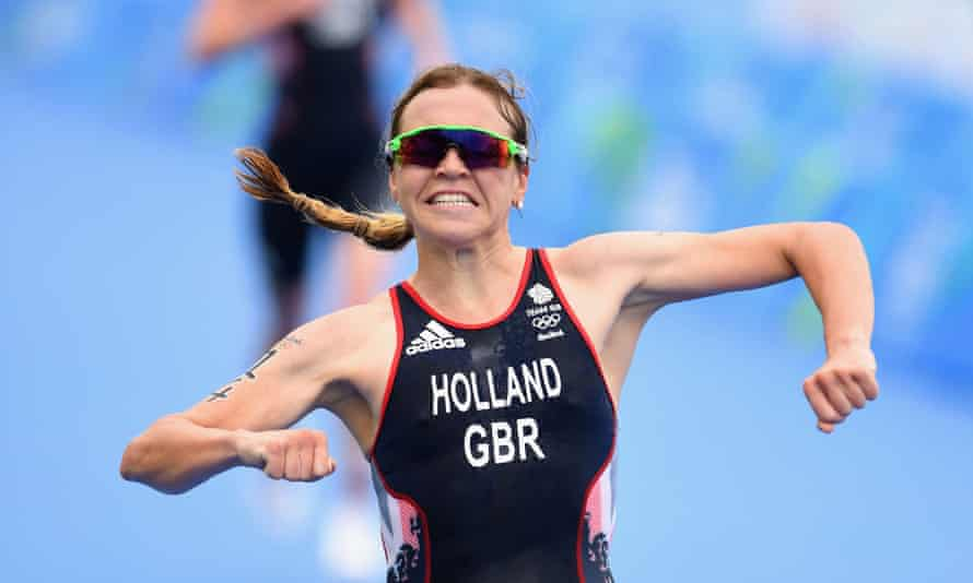 Vicky Holland celebrates as she approaches the finishing line to win bronze in the triathlon at the Rio 2016 Olympic Games.