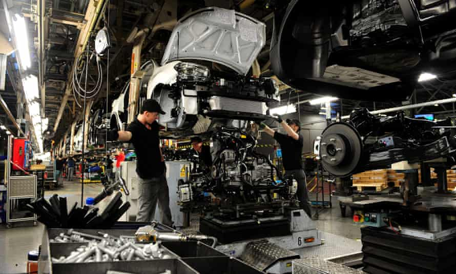 Workers assembling a car at Nissan's Sunderland plant