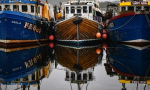 Fishing boats tied up at Tarbert harbour, south-west Scotland.