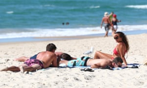 People relax on the beach at Burleigh Heads on Queensland's Gold Coast