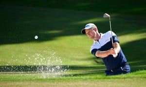ustin Rose of England plays a shot out of the bunker during in Antalya.