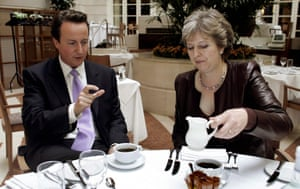 May pours the milk for the Conservative party leadership contender David Cameron during a meeting in Westminster in 2005