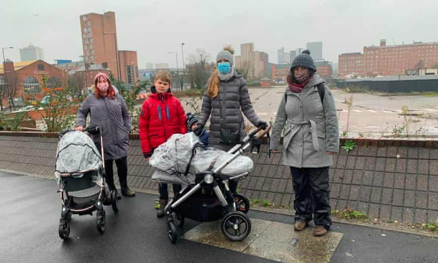 Campaigners Gemma Cameron, Julia Kovaliova and Claire McDonald with their children at the former retail park in Ancoats.