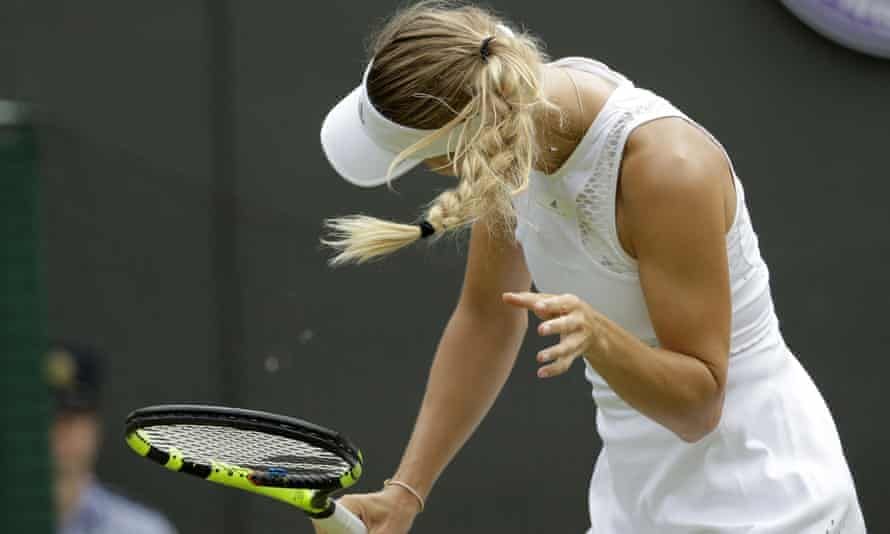 Caroline Wozniacki shakes her head to avoid the flying insects on court