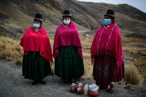 Three members of the Aymara community in Ayllu Hampaturi take part in a ritual to demand rain to their gods in La Paz, Bolivia