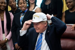 Washington D.C, USUS President Donald Trump puts on a hat given to him by the 2019 NCAA Division I champions from Baylor University's women's basketball team