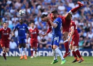 Liverpool's Virgil van Dijk clashes with Chelsea's Olivier Giroud as Chelsea win 1-0 at Stamford Bridge.