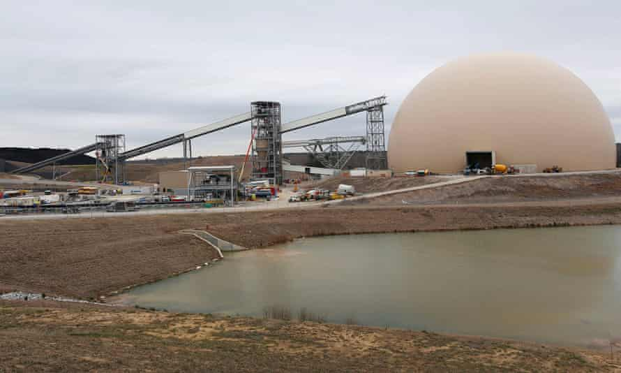 The dome for storing lignite coal stands next to Southern Co's Kemper County power plant under construction near Meridian, Mississippi on 25 February 2014.