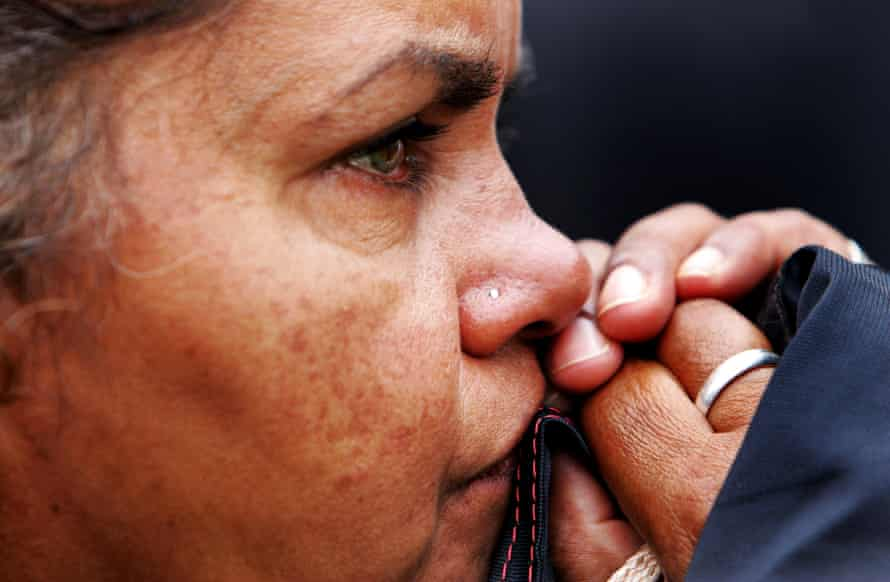An Indigenous woman in Canberra in February 2008, watching Kevin Rudd deliver an apology to Australia's first peoples. It was 'underwritten with deliberate legal caution to avoid reparation'