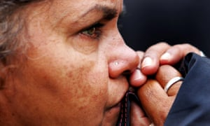 A woman watches Kevin Rudd's apology to Indigenous Australians on 13 February 2008.