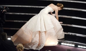 Jennifer Lawrence trips on the way to collecting her best actress award.