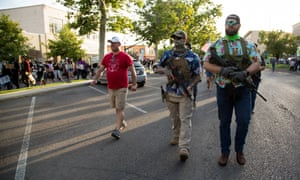 Armed counter protesters in Hawaiian shirts, suggestive of an affiliation with the boogaloo movement (a loosely organized far-right anti-government group), march in Provo, Utah.