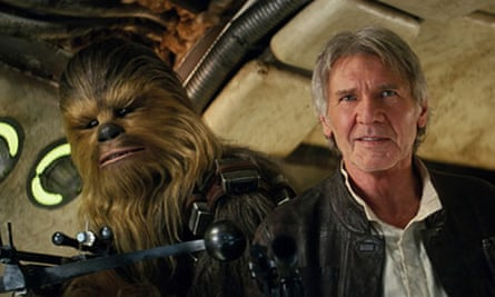 """Harrison Ford This photo provided by Lucasfilm shows Peter Mayhew as Chewbacca and Harrison Ford as Han Solo in """"Star Wars: The Force Awakens,"""" directed by J.J. Abrams. Lawrence Kasdan co-wrote the screenplay with Abrams. The movie opens in U.S. theaters on Friday, Dec. 18, 2015. (Film Frame/Lucasfilm via AP) -"""