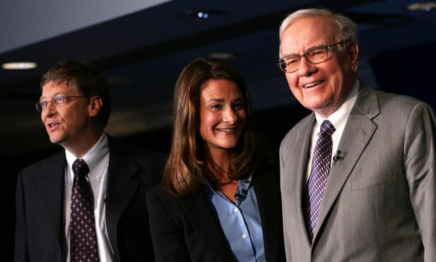Bill and Melinda Gates and Warren Buffett (right) are among the world's most charitable business moguls.
