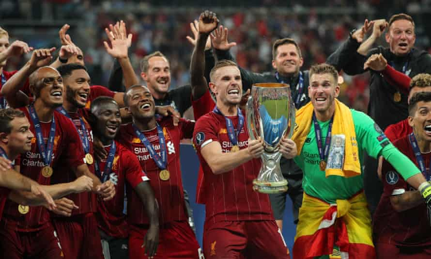 Jordan Henderson lifts the trophy surrounded by delighted teammates