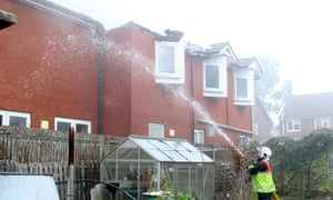 Firefighters at the Newgrange care home in Cheshunt, where two people died.
