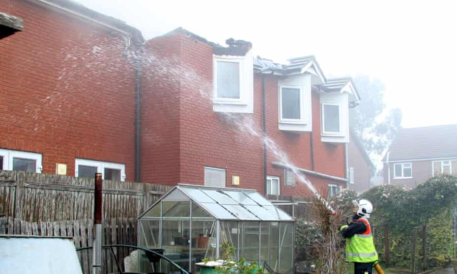 A firefighter puts out a blaze at a care home in Cheshunt.