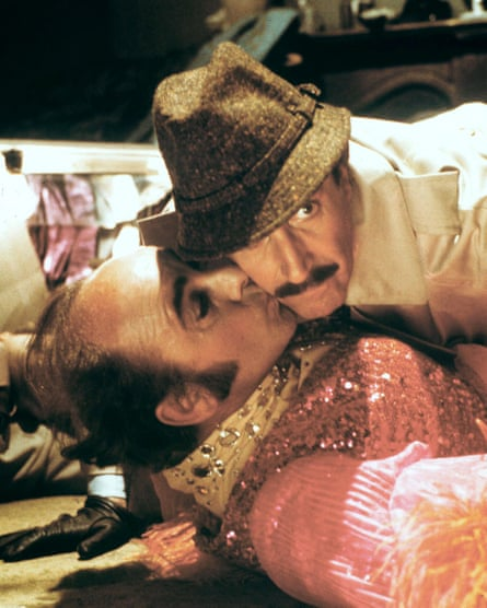 Michael Robbins, left, and Peter Sellers in The Pink Panther Strikes Again