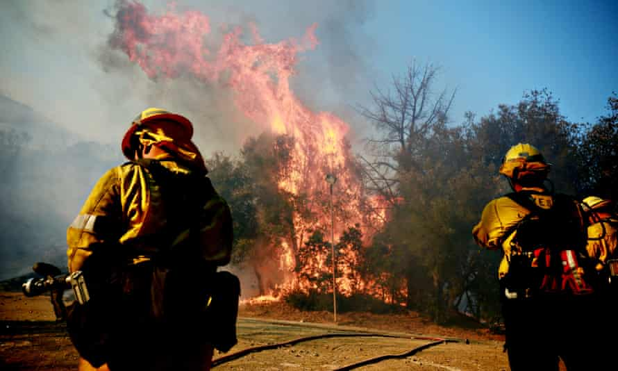 Firefighters battle a blaze at the Salvation Army Camp on 10 November 2018 in Malibu, California.