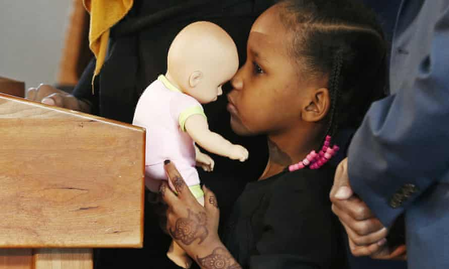 Four-year-old Somali refugee Mushkaad Abdi holds her doll during a Minneapolis news conference on 3 February 2017, one day after she was reunited with her family. Her trip from Uganda to Minnesota was held up by Donald Trump's order barring refugees from seven predominantly Muslim nations.