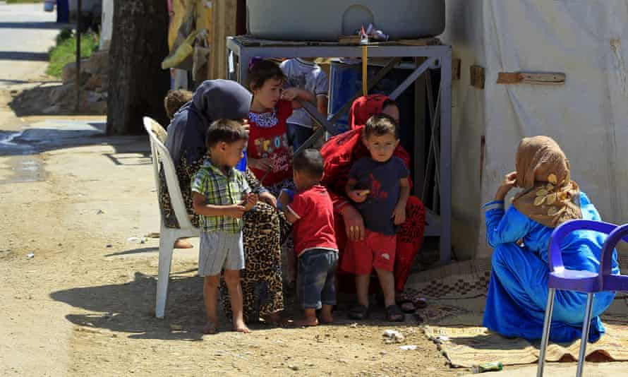 Syrian mothers and children at a refugee camp in the eastern Lebanese town of Saadnayel.