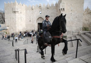 An Israeli mounted policeman stands guard outside Damascus Gate