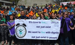 Unison living wage protestors holding a banner outside of the University of East Anglia