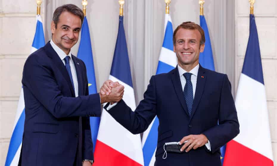Greek prime minister, Kyriakos Mitsotakis, left, shakes hands with French president, Emmanuel Macron, at the Élysée Palace