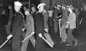 US armed forces personnel with wooden clubs during the 'zoot suit' riots in 1943.