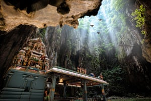 The Batu caves are on the outskirts of Kuala Lumpur, Malaysia. The main temple of Murugan is a Hindu shrine that sits in the centre of the caves, 100m and a steep 272-step journey above ground. In the caves, monkeys and backpackers jostle for position and birds fly overhead.