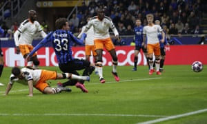 Hans Hateboer (33) slides in to open the scoring for Atalanta at the San Siro.