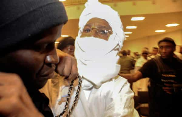 Hissène Habré reacts as he is escorted in to stand trial by police at the Palais de Justice in Dakar, Senegal.