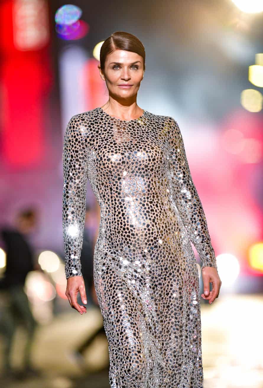 Head-to-toe metallics … Helena Christensen walks during the Michael Kors AW21 fashion show