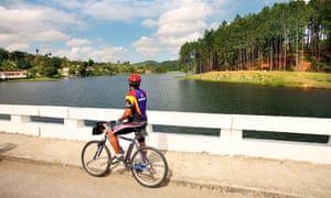 Cycling by the lake in Las Terrazas, Cuba.