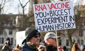 People take part in an anti-vaccination protest in Parliament Square, London.  (Luciana Guerra/PA Wire)