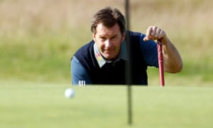 Sir Nick Faldo lines up a putt on the 17th green during the Open in 2015 at St Andrews