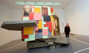 Phyllida Barlow poses beside her piece Untitled: upturned house, 2 (2012)