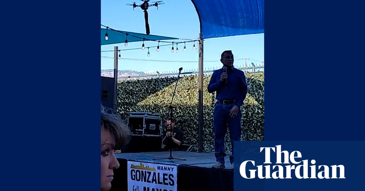 Albuquerque mayoral candidate interrupted by drone carrying sex toy – video