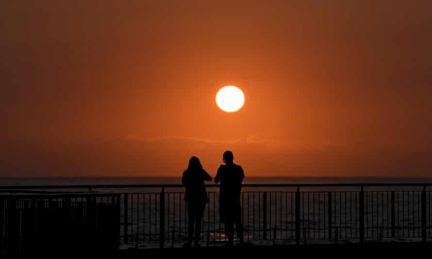 red sun rises over the sea