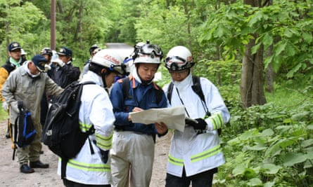 Rescuers search for 7-year-old Yamato Tanooka who is missing after being left in a forest as a punishment by his parents on Hokkaido Island, Japan.