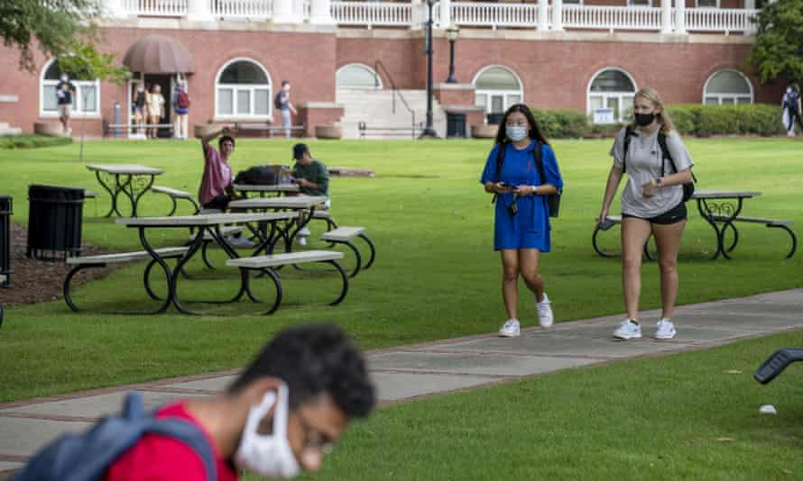 Students wear face masks as they walk through the Georgia College and State University campus in Milledgeville, Georgia, on 21 August.