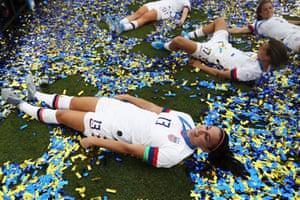 Alex Morgan of the USA celebrates in the confetti.